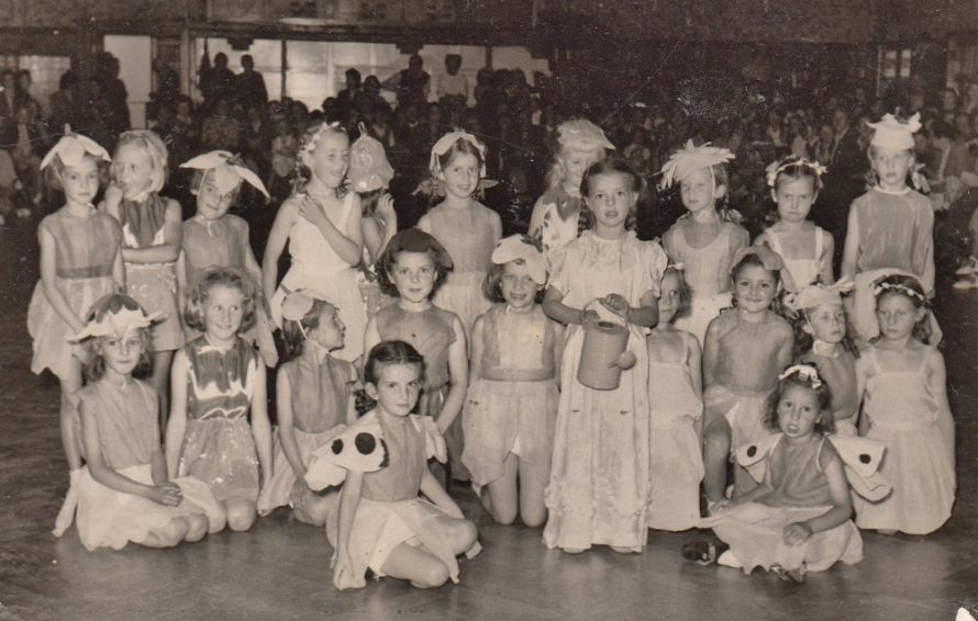 Wendy Baker aged about 7 with her Girls Brigade 'Mary, Mary Quite Contrary' in a church hall | Mary Baker