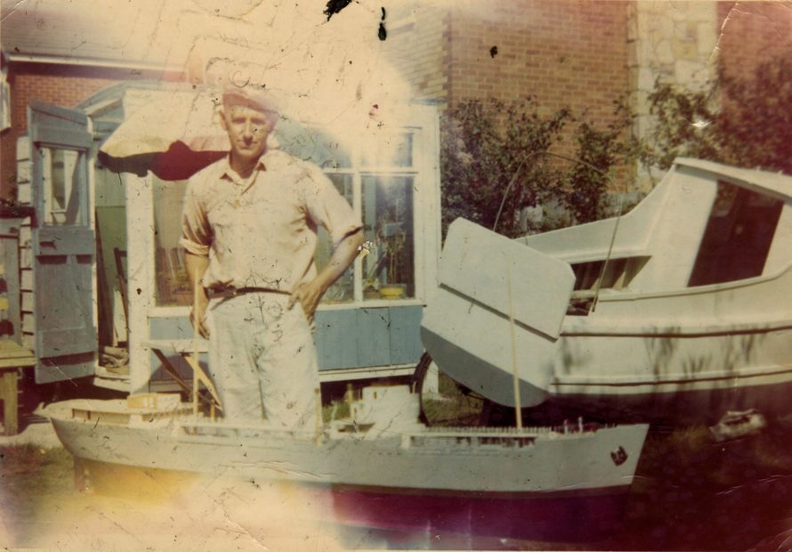 On the back of this photo it says - George with one of my last oil tankers I built 1970. Then it says summerhouse dad built.