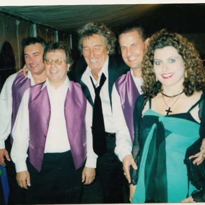 Band members including Fred Ford who played keyboard and Dave Docherty with Rod Stewart in the marquee set up in Rod's garden in Epping. | Lee-Ann Green