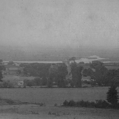 Looking south from the top of Vicarage Hill shows Canvey Island in the distance. In the middle you can see St Mary's Church.