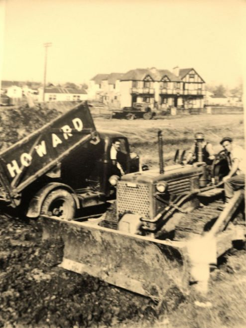 Dad's seen here delivering muck to help build the seawall.   J.Walden