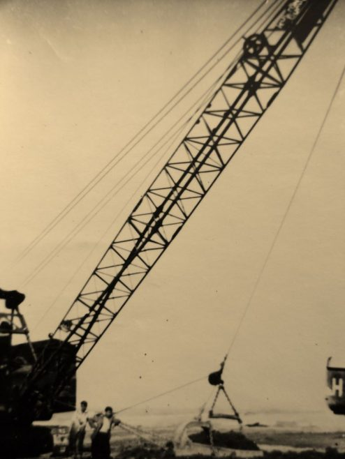One of the big cranes used to shovel muck into place on the new seawall.   J.Walden