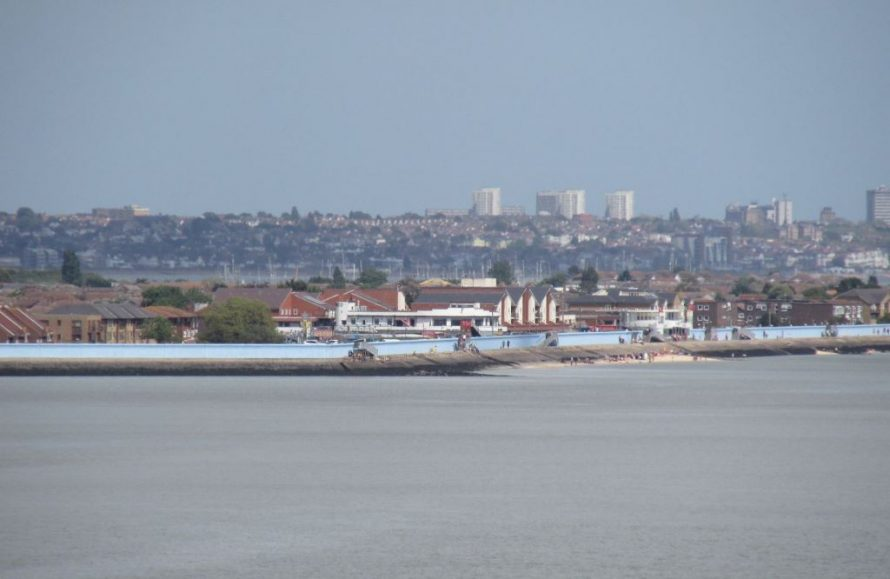 Sea wall with Monico pub visible. In the background are the high rises of Southend on Sea. | J.Walden