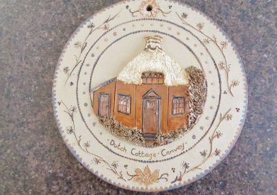 A Pottery plaque of the Dutch Cottage.