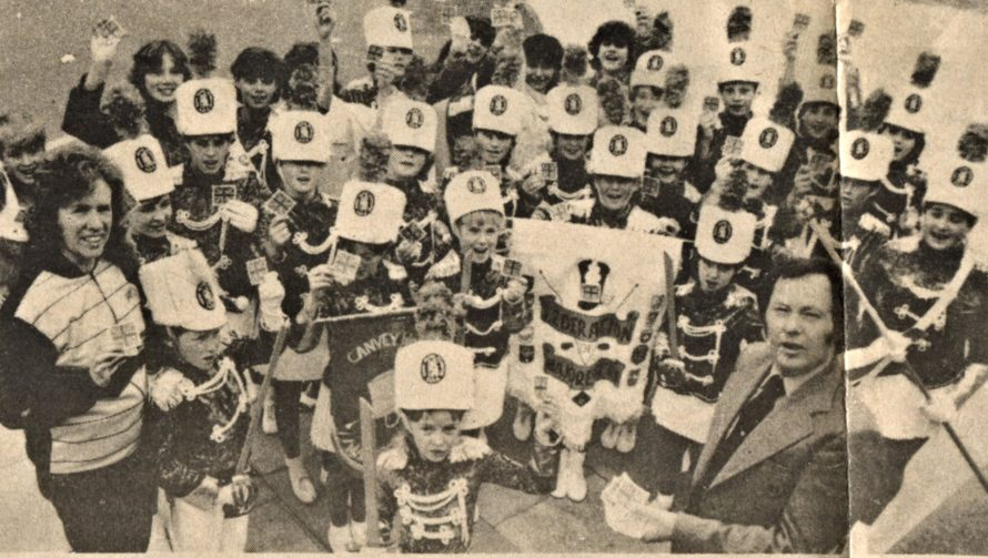 Showing the flag: Coun Ray Howard presents the majorettes with their Union Jack badges before the troupe heads for Holland | Echo Newspaper Group
