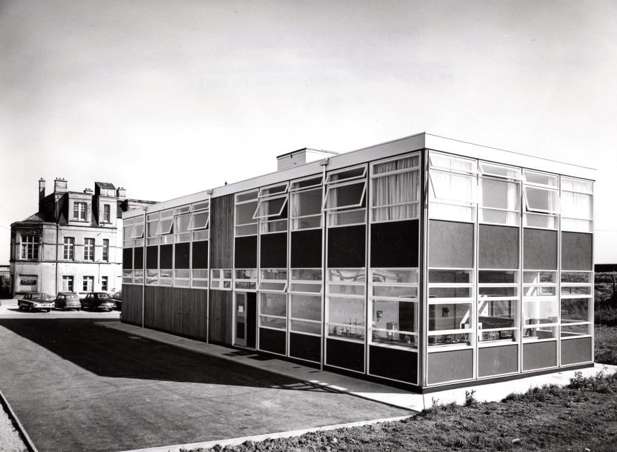 The new offices with the old offices (Kynoch Hotel) on the left. See close-up below.