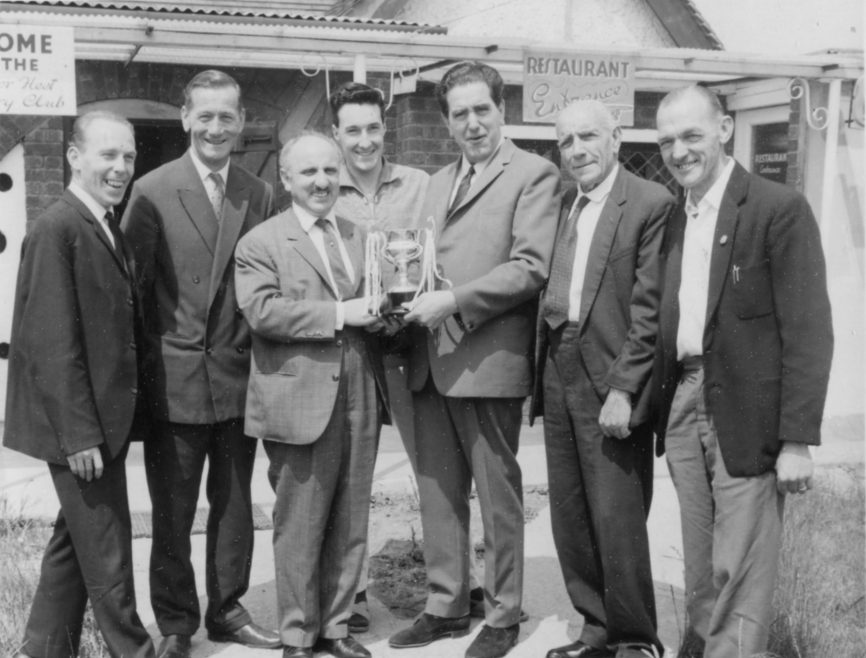 No idea where or when. But an award, something to do with a restaurant. In the photo Sid Alterman and George Piickett. | Jose Joseph