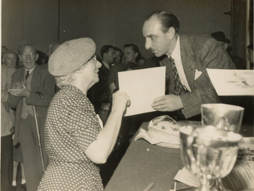 Sid Alterman gives out the awards. No idea when or where. | Jose Joseph