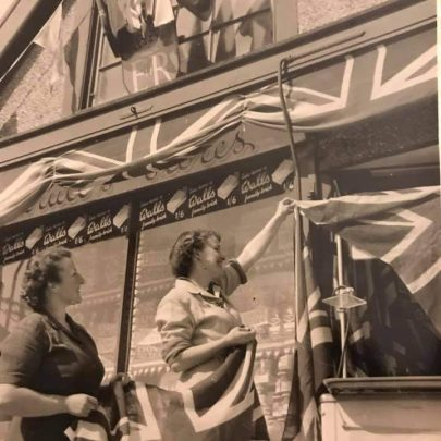 LIz: My mum and Aunt putting the flags up for the coronation | Liz Bushell
