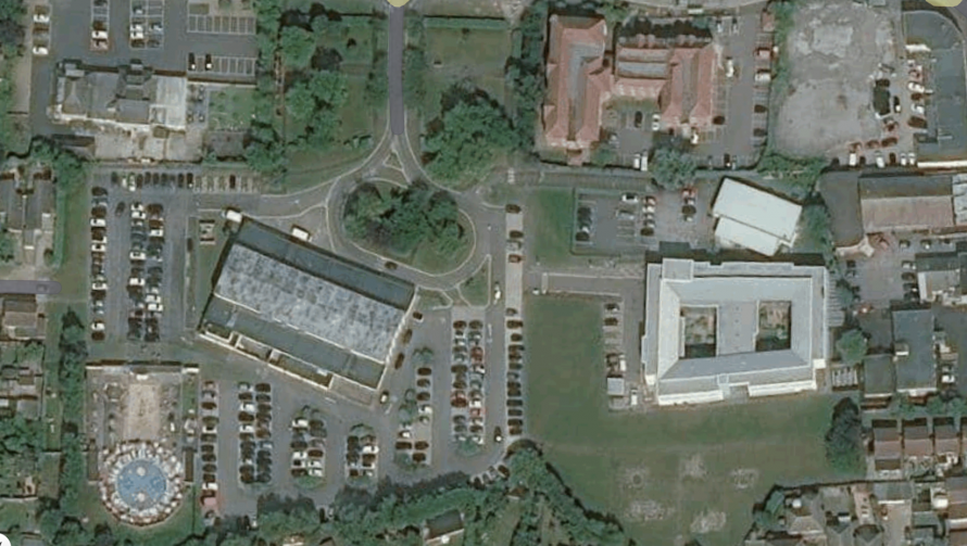 Google photo showing the hospital building and how little room is left for a new hall.
