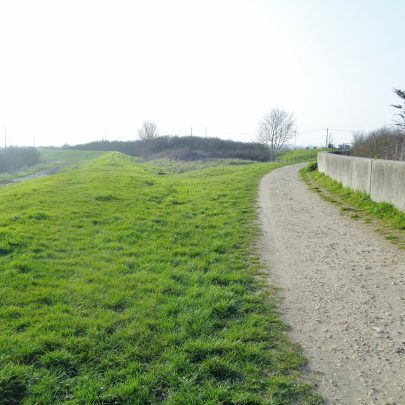 The old wall bears left to Waterside Farm, the new bears right to the Benfleet Barrier.