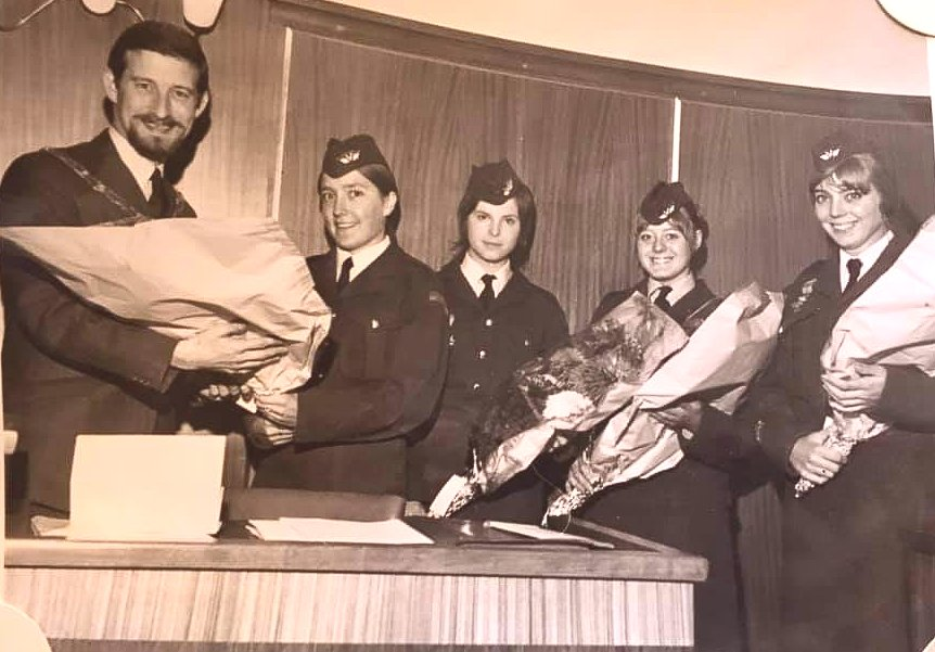 Brian Beasley chairman of Canvey Council presenting my sister Beverley Payne, Gillian Deliue Ann Burridge and myself Janet Payne bouquets of flowers in thanks for being able to give a letter of thanks to The Burgomaster of Nijmegen thanking the people of The Netherlands for all the help they gave the people of Canvey during the 1953 floods. We were able to do that whilst taking part in the Nijmegen marches which is 100 Mile March that takes place over 4 days marching in the shape of a 4 leaf glover with 30.000 other service men and women from 21 different countries marching in unison together to remind us that we must live in peace and harmony following WW11 and remembering the atrocities that happened especially in The Netherlands including the famous Arnhem drop. I enjoyed the experience including blisters, cramps, drinking black tea and coffee with a teaspoon of salt in it. 🤢so much that I went back and did it again the next year.