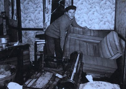 Pat Thain cleaning up after 1953 flood