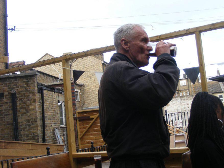 Lew enjoys a pint.