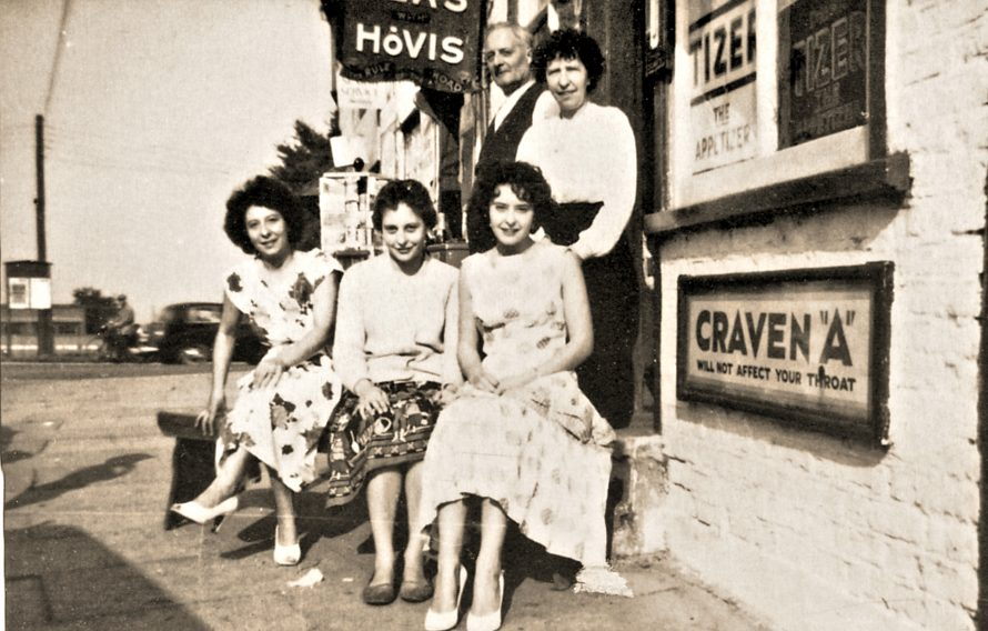The brown family outside their Café.