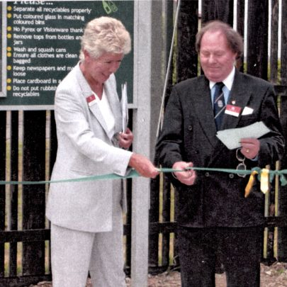 Kay Twitchen assists Ray Howard with the cutting of the ribbon