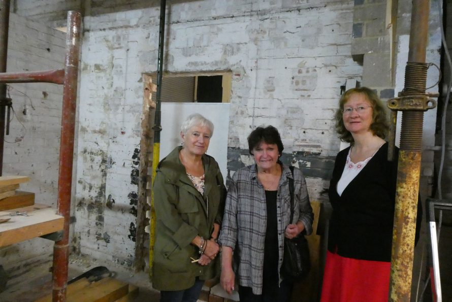 Robbie Banthorpe, Sue Page and Janet Walden pictured having a look at the area of the bus museum where they will have a permanent presence once the renovations have finished.