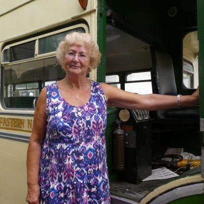 Pat with one of the old buses | © Janet Penn
