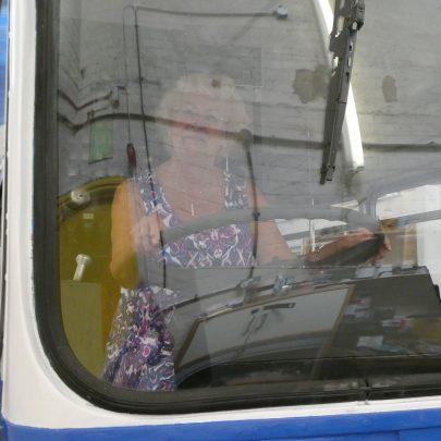 Mayor Pat in her new job as bus driver | © Janet Penn