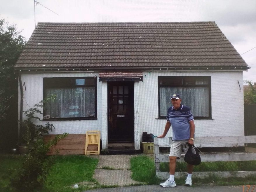 Barry outside the bungalow where he was born in 1941.