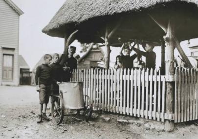 Children's Camp boys at the village pump