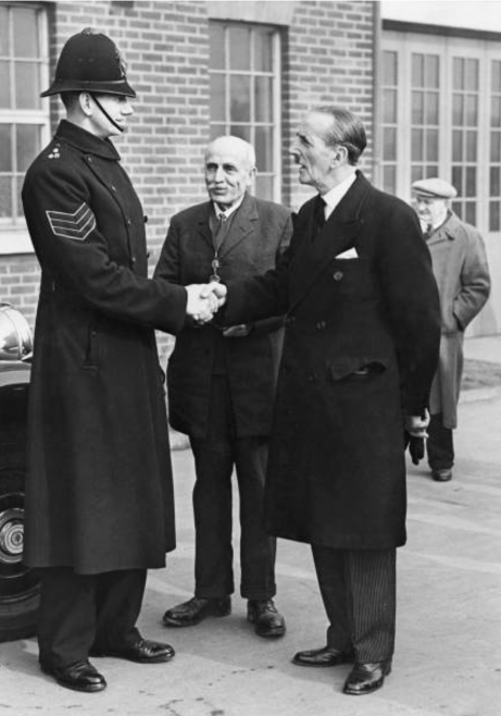 At 6 foot 6 inches Sergeant Howes was the tallest Canvey Policeman. He is pictured here being introduced to the Lord Mayor of London Sir Rupert De La Bere by Councillor Pickett. Sir Rupert congratulated William on his rescue work.