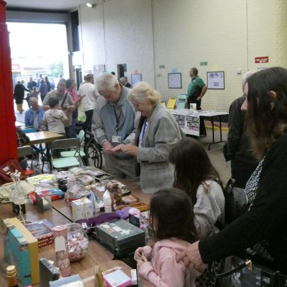 Busy at the archive's stall   © Janet Penn