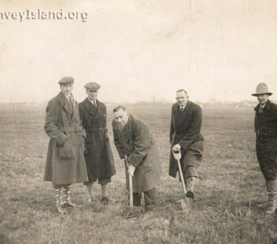 1933: Mr A.H. Beaumont in the centre cutting the first sod for the Casino. His brother Albert Beumont is far right and the Architect Eugene Laurence is second left. | ©Swann