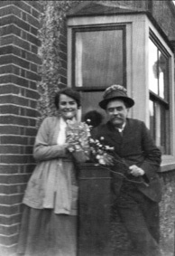 Alice and her father Charles Pound (Joan's husband's granddad) in a playful holiday mood at Gafzelle Drive, with flowers about his hat...