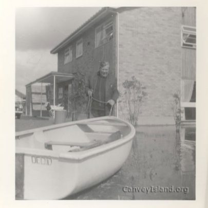 Harry Wright, local butcher(retired) inspects 'Dedida's' mooring. | T.Stevens