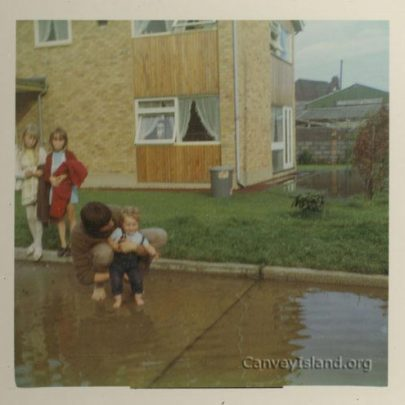Trevor takes toddler Paul Stacey for a paddle outside Mum and Dad's house, No.1 Gafzelle. | C.Stevens