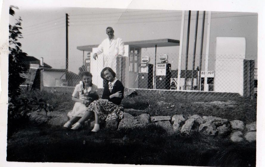 Dad, me and Christine Small 1960 new forecourt background. Chris' dad was the manager of the Co-op grocery store.