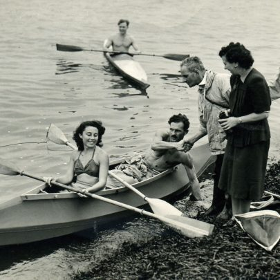 Roland Prout in canoe Mrs. G Prout far right | Shiner and Holmes