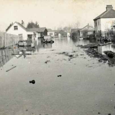 Our house viewed from the junction of High Street and Korndyke Road as the floodwater was subsiding in 1953. I was very young at the time, but remember being lifted out of an upstairs window into a rowing boat. My Aunt and Uncle lived in my Grandfather's bungalow in Larup Avenue, and their garden backed onto ours. They swam across to our house, where we all took refuge upstairs. Korndyke was an unmade road in those days, and you couldn't drive down it as there was a dyke running across it. 'Hope Villa' was a semi-detached house, and next door was called 'Montrose'. The Dowler family lived there. | George Payne