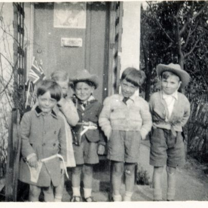 Outside our house in Korndyke Road. As the Queen's picture is on the front door, it must have been at the time of the Coronation in 1953, and after the flood. I'm the one with the silly cowboy hat in the middle, and my brother Derek is on the right. Between us is George Young, and hidden at the back is Anne Young. Their parents owned the newsagents at the junction of Korndyke Road and the High Street. I can't remember the boy at the front, but he's obviously one of our gang! | George Payne
