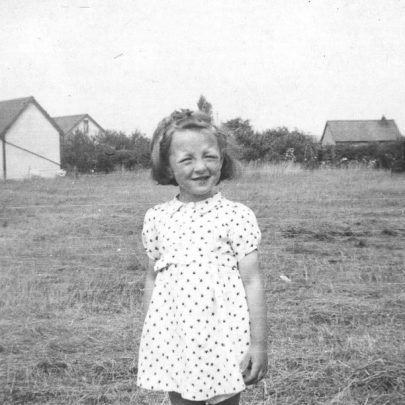 Val says this is me in the fields I enjoyed so much between Pax and River Mist. Other children and I would flatten the very tall grass in small circles to make homes to play in. It was lovely for a child who lived most of the year in the East End of London where even the school playgrounds were all concrete and our play spaces were in the ruins of houses destroyed by bombs. | Val Wright