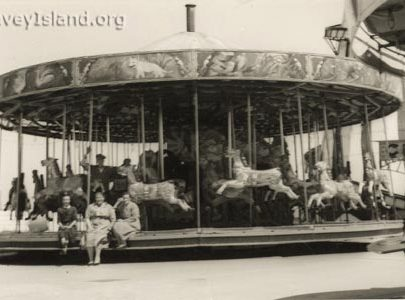 Merry go Round 'The Gallopers' with Maggie Taylor (left) & Mrs Thomas | © The Swann Family