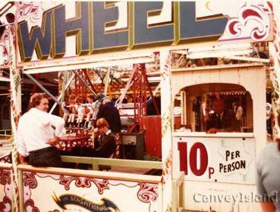 Clary Swann operating the big wheel (wearing cap) on the old speedway site | © The Swann Family
