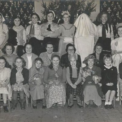 Fancy Dress Party. Front row from the left 3rd girl Doreen Anderson. Next row Robert Anderson then me, Mrs Daws, Mrs Mortimer and Miss Allbutt. cChristmas 1949 | Greta Parker Quaif was Anderson