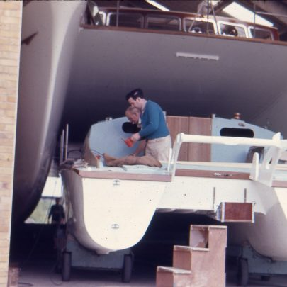 Work on a smaller catamaran between hulls | Ian