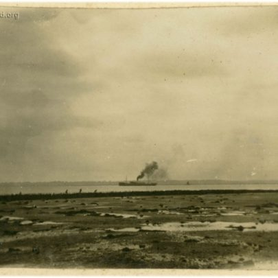 1922: A steam ship in the Thames with what looks like the Stuckey girls playing on the old Dutch Sea Wall | David Bullock
