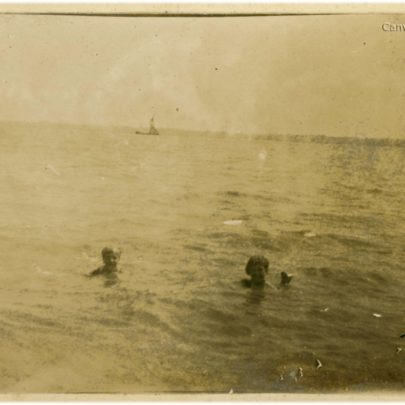 1922: Swimming at Canvey Beach with a Thames Barge in the distance | David Bullock
