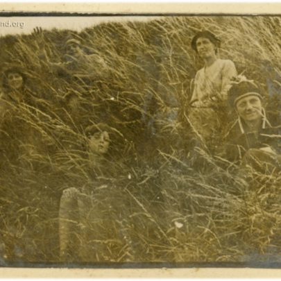1922: Stuckey family in the long grass of the Sea Wall