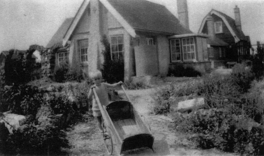 Lake House with the bungalow Jethou behind. Gregson's younger son Anthony in the front | Leonie Gregson