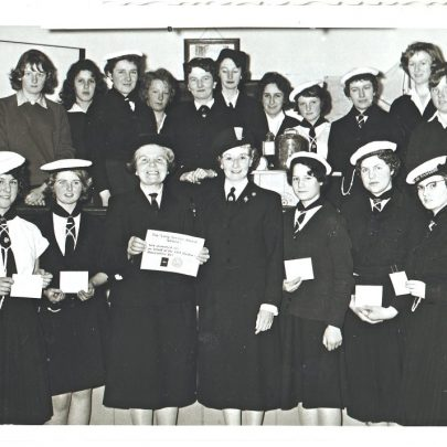 Madge with the Commissioner when she was presented with a long service award from the Girl Guides. On the left front row Pat Diamond (Hunt) and Nicky Stevens. | Pat Hunt