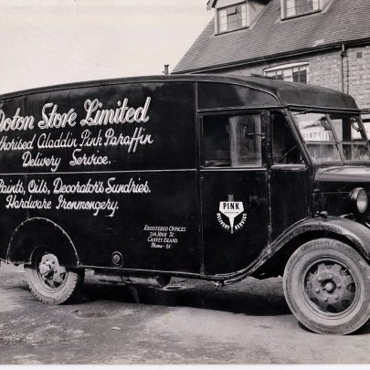 Delivery lorry with the Co-op grocery store in the background, 1957.