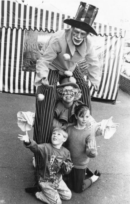 Up in the air: Tall clown Jacko and his daughter Wacko teach brother and sister Lee and Donna Cox how to juggle. | Echo newspaper group