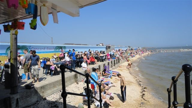 This photo was taken this year from the Concord Cafe again looking towards the pool. The wall has been raised and the tide is in. Still a busy place in the sun. | FOCB