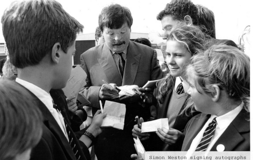 Dated 1989.Simon Weston signs autographs for some of the pupils. | Echo Newspaper Archive