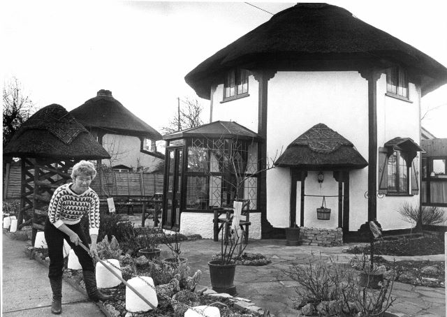 Mrs Ivy Martin in front of her replica Dutch Cottage | Echo Newspaper Group